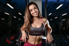 Beautiful fitness woman trains in the gym Royalty Free Stock Photography