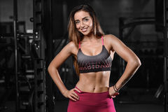 Beautiful fitness woman trains in the gym Royalty Free Stock Image