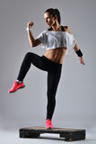 Beautiful fitness woman working out Royalty Free Stock Photography