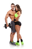 Beautiful fitness young sporty couple with dumbbell. Isolated over white background royalty free stock images