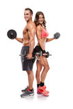 Beautiful fitness young sporty couple with dumbbell Royalty Free Stock Photography