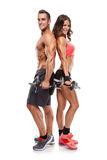 Beautiful fitness young sporty couple with dumbbell Stock Photos