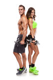 Beautiful fitness young sporty couple with dumbbell. Isolated over white background royalty free stock photo