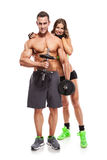 Beautiful fitness young sporty couple with dumbbell Stock Images