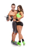 Beautiful fitness young sporty couple with dumbbell Stock Image
