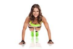 Beautiful fitness young woman doing pushups Stock Photo