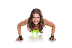 Beautiful fitness young woman doing pushups Royalty Free Stock Image