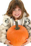 Beautiful Five Year Old Girl With Pumpkin. Beautifulf five year old girl wearing coat holding pumpkin. Shot in studio over white Stock Photography