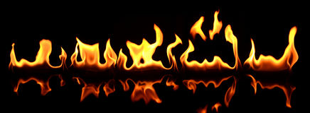 Beautiful flame reflected in the foreground Stock Photo