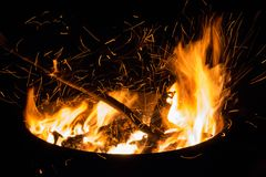 Beautiful flame with sparks in bonfire in the night. Heat and danger energy concept. Fire on black background. Beautiful flame with sparks in bonfire in the royalty free stock photography