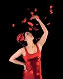 Beautiful flamenco girl with rose petals Stock Images