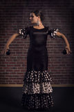Beautiful Flamenco woman dancing with castanets Royalty Free Stock Image