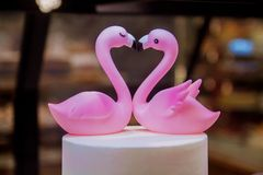 Beautiful figure of flamingos, a symbol of love. Two pink flamigo figures kissing, happy Valentine`s day. stock photography