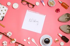 Beautiful flatlay frame arrangement with cosmetics, planner, cup of espresso, glasses and other beauty or business accessories wit. H a page with handlettering Stock Photos