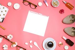 Beautiful flatlay frame arrangement with cosmetics, planner, cup of espresso, glasses and other beauty or business accessories wit. H a blank page with copyspace Stock Images