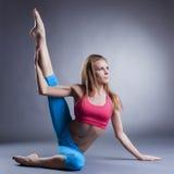 Beautiful flexible girl doing stretching exercises Stock Image