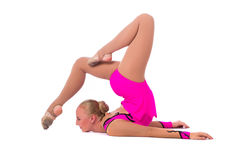 Beautiful flexible girl gymnast. Over white background royalty free stock photo