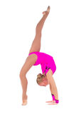 Beautiful flexible girl gymnast staying in a hands. Tand over white background stock photography