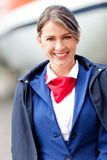 Beautiful flight attendant Stock Photo