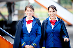 Beautiful flight attendants Stock Photography