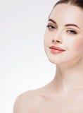 Beautiful flirt woman face close up portrait studio on white Stock Photos