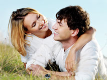 Beautiful flirting couple on nature Royalty Free Stock Photography