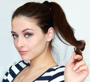 Beautiful flirting young woman holding hair Royalty Free Stock Photo