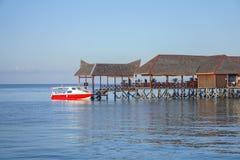 Beautiful floating chalet at mabul island aand blue sky Royalty Free Stock Photo