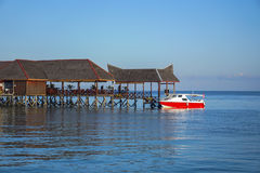 Beautiful floating chalet at mabul island aand blue sky Stock Image