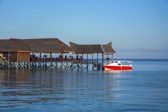Beautiful floating chalet at mabul island aand blue sky Stock Image