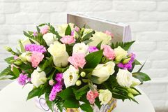Beautiful floral arrangement in a hat box royalty free stock photo