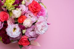 beautiful floral arrangement, pink and red rose, pink eustoma, yellow chrysanthemum Stock Images