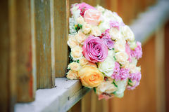 Beautiful floral bouquet and wooden fence Stock Images