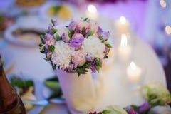 Beautiful floral centerpiece at wedding reception table closeup Royalty Free Stock Photos