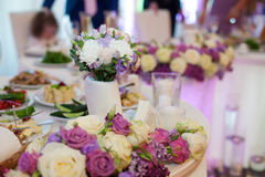 Beautiful floral centerpiece at wedding reception table closeup Stock Photography