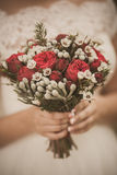 Beautiful floral composition in hands of young bride Stock Photos