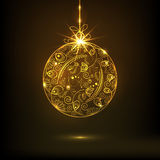Beautiful floral design decorated golden X-mas Ball for Merry Christmas celebrations. Beautiful floral design decorated golden X-mas Ball on brown background Stock Photography