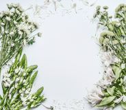 Beautiful floral frame layout with green flowers for bouquet making on white background. Top view royalty free stock image