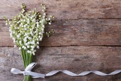Beautiful floral frame with lilies of the valley. Flowers on old wooden table. horizontal Royalty Free Stock Photography