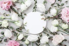 Beautiful floral mockup of pastel flowers and green eucalyptus leaves on grey table top view. Flat lay greeting card. Beautiful floral mockup of pastel flowers royalty free stock image