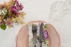 Beautiful floral theme table set for an occasion Royalty Free Stock Image