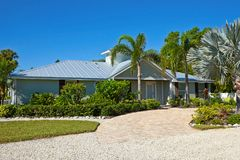 Beautiful Florida House. With Palms Trees and Landscaping stock photo