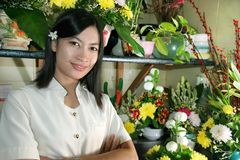 Beautiful florist at work. Photograph of florist at work. this series here stock photography