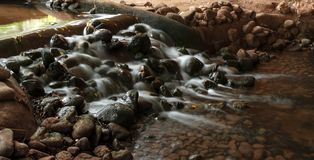 Beautiful flow of water in small stream, long exposure at the Birds valley park in Agadir royalty free stock images