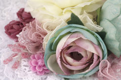 Beautiful flower arrangement. Brooch made of silk flowers with lace and ribbons Stock Photos