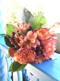 Taos desert wedding bouquet peach burgundy Stock Photos