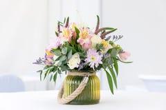Beautiful flower arrangement on white festive table Stock Photo