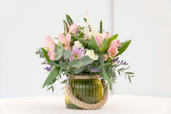 Beautiful flower arrangement on white festive table Stock Photos