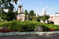 Beautiful flower bed next to the buildings of monastery Royalty Free Stock Image