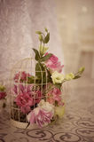 Beautiful flower bouquet in bird cage Stock Image
